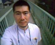 宮島賢也先生顔写真